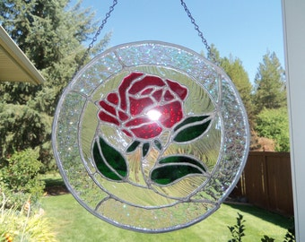 A beautiful rose in a round stained glass panel