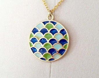 Gold enamel pendant necklace with blue and green scallops