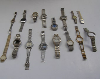 Lot of 16 (1000gr} old different used watches & straps for parts only