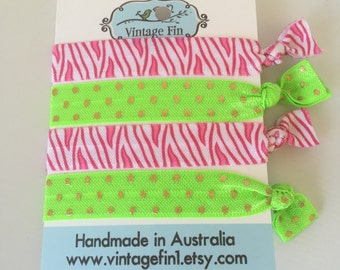 Set of four pink and lime green  elastic hair ties