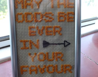 Hunger Games inspired cross stitch.