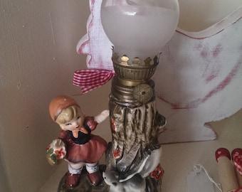 vintage girl oil lamp