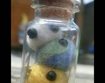 Needle felted Planets in a bottle.