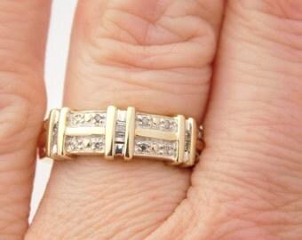 Ladies Round & Baguette Cut Diamond Band 10K Gold