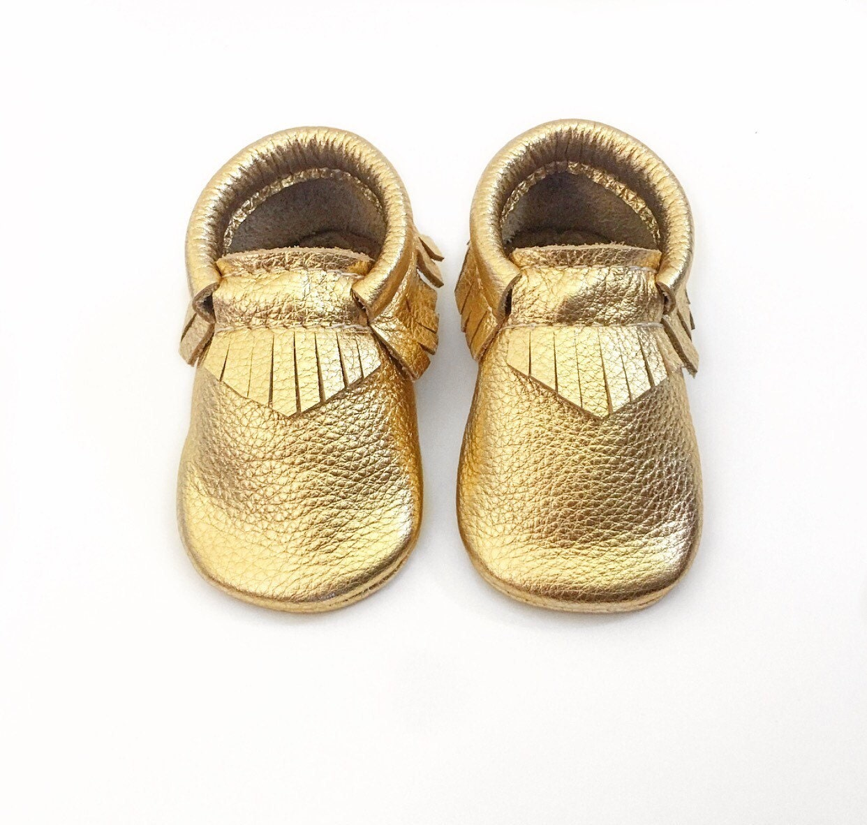 At Freshly Picked, we design unique, premium and useful products for families. Our classic diaper bag, soft-sole baby moccasins, and kids' sneakers are made to be durable, functional, and look amazing.