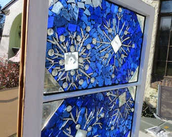 Snowflake stained glass mosaic window.  Stained glass mosaic vintage window . Glass on glass mosaic window.