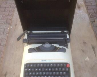 Old typewriter OLIVETTI LETTERA 12 Portable Vintage