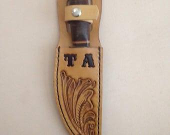 Hand tooled leather knife sheath