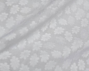 Vintage white floral gauzy eyelet fabric