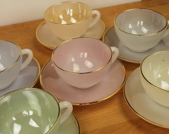 Harlequin Arcopal Gilt-edged cups and saucers x 6