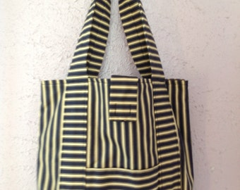 Tote, hand or shoulder bag. Navy and cream striped with outer pockets.