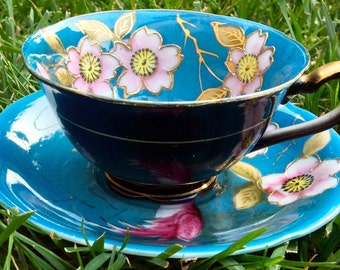 Gorgeous Hand Painted Moriage Japan Teal Footed Teacup and Saucer With Pink and Gold