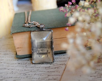 WISTFULNESS - Nostalgic terrarium pendant with dried baby's breath and a cutout from a 100 year old newspaper, pressed flower necklace