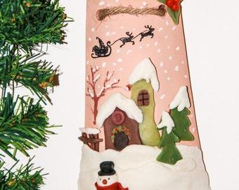 Decorative terracotta shingle representing a snowy landscape