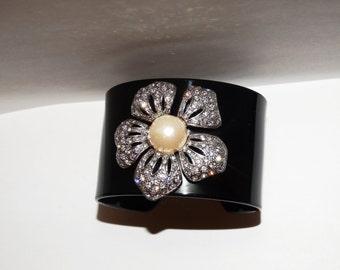 Vintage Black Plastic White Rhinestone Flower Cuff Bracelet.