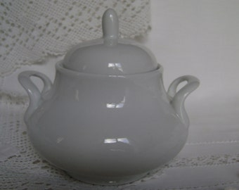 White china sugar bowl with lid. Will mix or match with any style or pattern.
