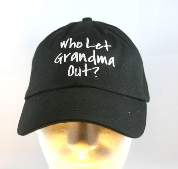 Who Let Grandma Out? (Polo Style Ball Black with White Stitching)