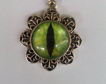 Cat's eye pendant. Glass eye cabochon pendant.