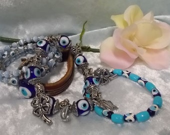 Set of four bracelets from Turkey made of beads, leather and charms in different shades of blue.