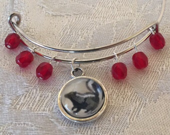 Glass Skunk And Red Crystal Adjustable Silver Tone Wire Bracelet