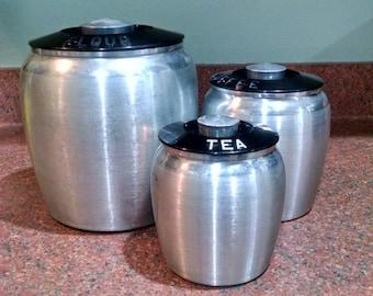 Kromex Brushed/Spun Aluminum Canisters  - Set of Three - Flour, Coffee, Tea - 1950s