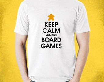 Keep Calm and Play More Board Games T-Shirt | board gamer t-shirt with a colour meeple for BoardGame geeks and tabletop gamers | Keep Calm