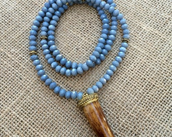 Blue gray crystal beaded necklace with brown ox bone tusk