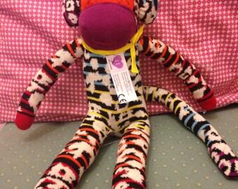 Jazzy the rainbow sock monkey