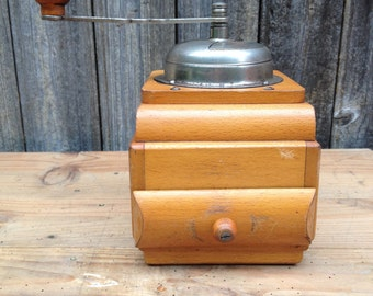Former decorative arts table coffee grinder