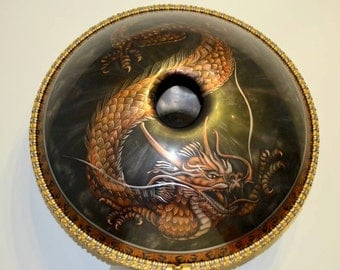 V&OMana handpan with dragon design in Akebono tuning - musical sculpture