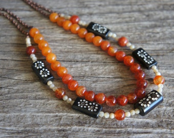 Double strand necklace with bone amber, agate, quartzite and mother of pearl beads