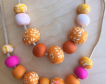 Orange and White polymer clay necklace