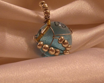 Ocean blue mocaic glass pendent with glass & metallic beads.