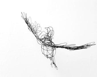 wire sculpture flying birds