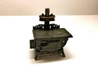 """Vintage Collectible Dollhouse Miniature Stove with a pencil sharpener, 1970's, 4"""" Tall"""