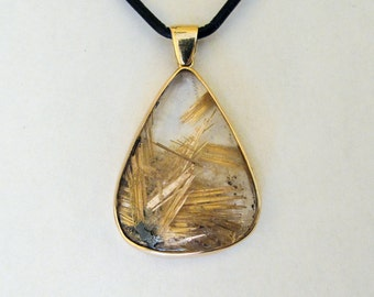 14 kt yellow gold rutilated quartz crystal pendant