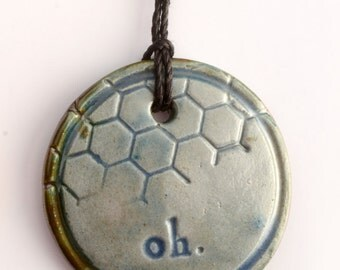 cobalt blue ceramic pendant necklace with oh & honeycomb texture