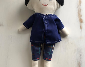 Boy doll with black hair and skulls