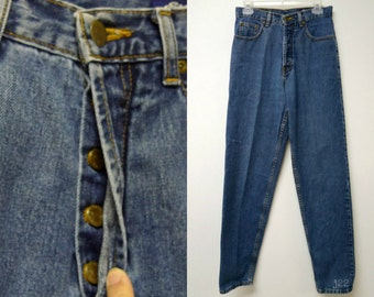 """Eddie Bauer . 1990s high waist . loose fit . button fly . blue denim jeans . long . size 8 . waist 28.5"""" . length 44"""" . made in USA"""