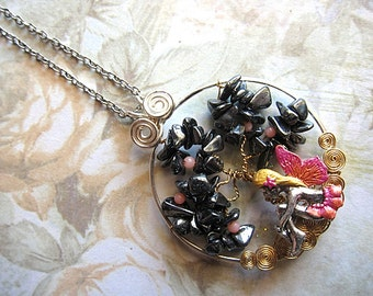 Fairy Is Sitting Underneath Hemitite Tree Of Life Necklace Fae Fay Faerie Realm Fantasy Mystical Magical Nature Enchanted Gemstones