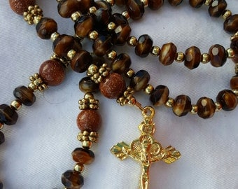 Amber swirl rosary with goldstone pater beads
