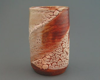Tumbler, wood-fired stoneware w/ crawling shino and natural ash glazes
