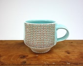 Aquamarine glazed porcelain mug with knit pattern and dotted texture