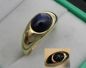 AAA Blue Star Sapphire cabochon   9x7mm  2.72 Carats   14k yellow gold ring  8 grams 0154