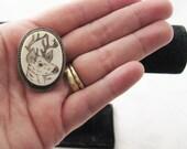 Stag - vintage 1970s scrimshaw brooch pendant