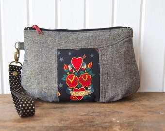 Gerbera Wristlet in Alexander Henry Tattoo Too with Essex Gold Metallic Linen