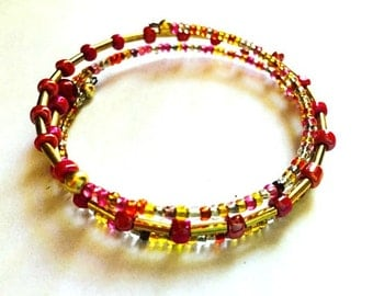 Bracelet - Beaded Memory Wire - Golds and Reds and Pinks - Shiny Seed Beads and More - One Size Fits All