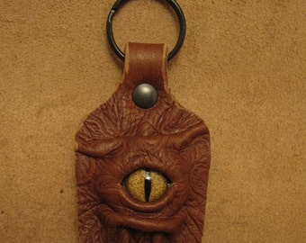 Grichels leather keychain - embossed brown with gold speckled slit pupil reptile eye