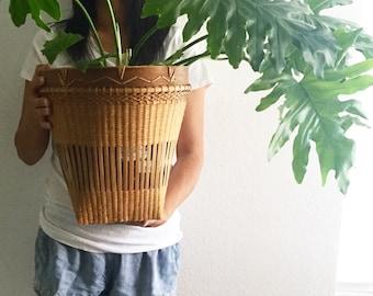 mid century woven rattan bamboo basket planter / tribal