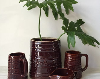 stoneware set of mugs and canister / cookie jar / creamer cup / brown